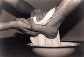 Humble serving as an example by the washing of feet.